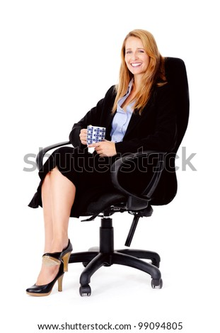 Business woman sitting in office chair relaxing with a cup of coffee isolated on white