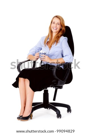 Business woman sitting in office chair relaxing with a cup of coffee isolated on white - stock photo