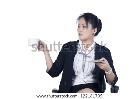 Business woman sitting in office chair with a cup of coffee, isolated on white. Model is Asian woman. - stock photo