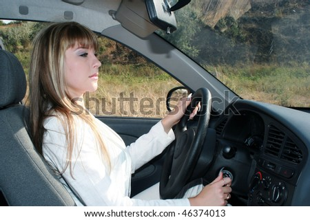 Business woman sitting in the car