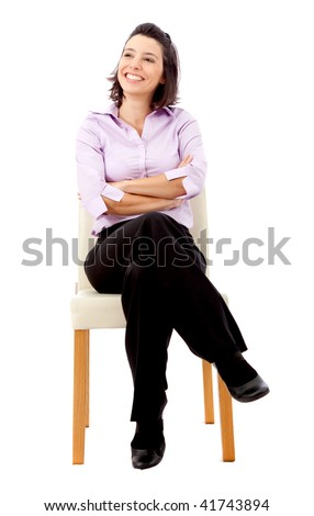 business woman sitting on a chair isolated over a white background - stock photo
