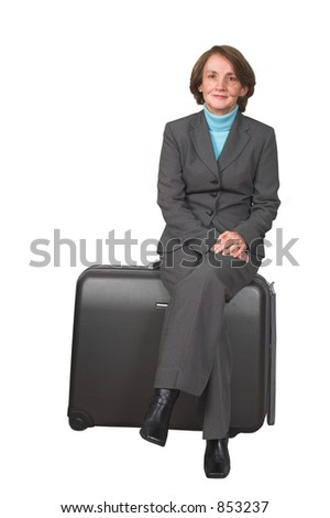 business woman sitting on a suitcase