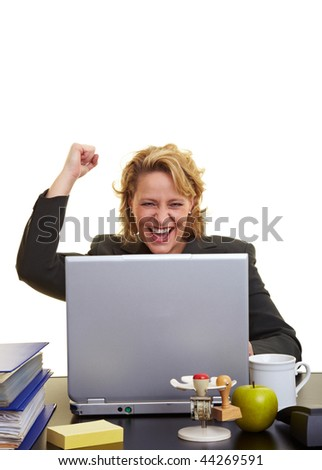 Business woman sitting with laptop at her desk - stock photo