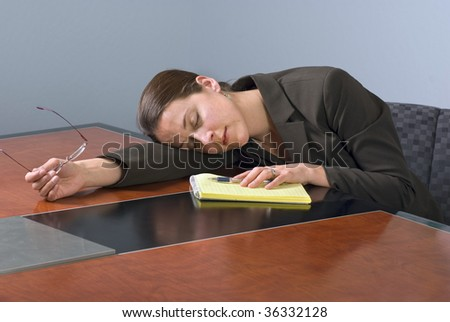 Business woman sleeping on a conference table.