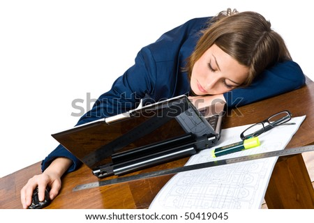 Business woman sleeping on the laptop at her desk - stock photo