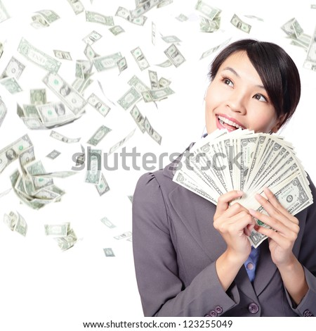 business woman smile happy with handful of money with money rain, asian beauty model - stock photo