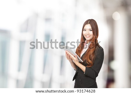 Business woman smile using tablet pc, model is a asian beauty - stock photo