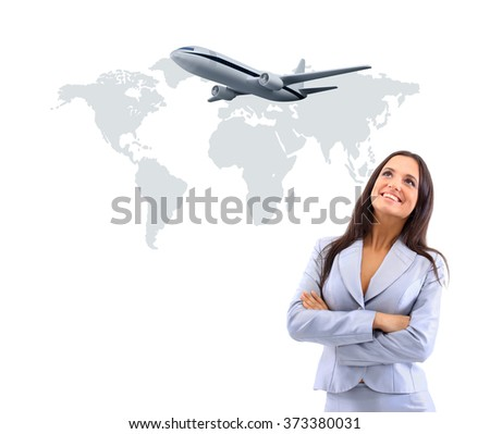 business woman smileeng and looking at airplane - stock photo