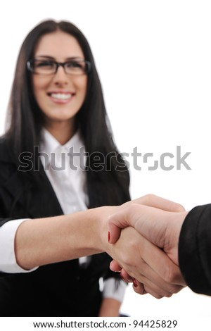 Business woman smiling and handshaking - stock photo