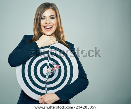 Business woman smiling and holding big target of darts. Success concept portrait. - stock photo