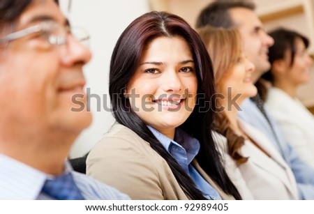 Business woman smiling in a corporate meeting