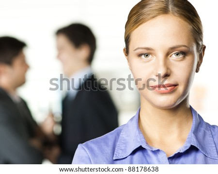 business woman smiling, in an office - stock photo
