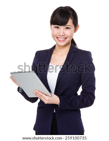 business woman smiling using tablet pc - stock photo