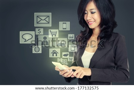business woman smiling while using Modern communication technology mobile phone concept on high tech background - stock photo