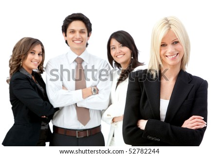 Business woman smiling with a group behind her - isolated over white