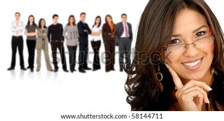 Business woman smiling with her team behind her - isolated over white - stock photo