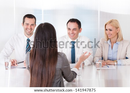Business Woman Speaking At Interview In Office - stock photo