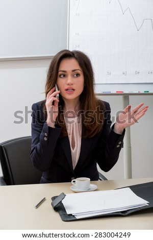 Business woman speaks on the phone. Administrator at the workplace. - stock photo