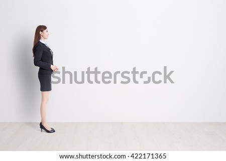 business woman stand profile with white wall background, great for your design or text, asian - stock photo