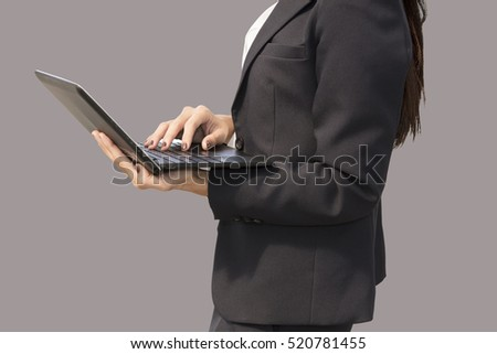 business woman stand using laptop