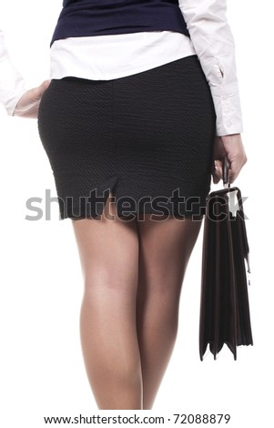 business woman standing and holding a briefcase - stock photo