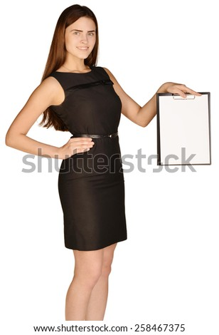 Business woman standing and holding in hands clipboard - stock photo