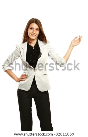 Business woman standing in full length isolated on white background and pointing at something.