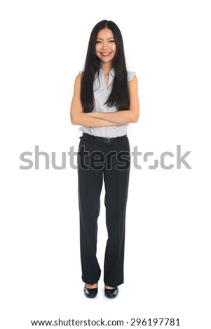 Business woman standing in full length isolated on white background. Beautiful mixed race Chinese female mode in suit. - stock photo