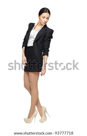 Business woman standing in full length looking down isolated on white background