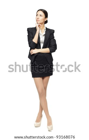 Business woman standing in full length looking upwards isolated on white background