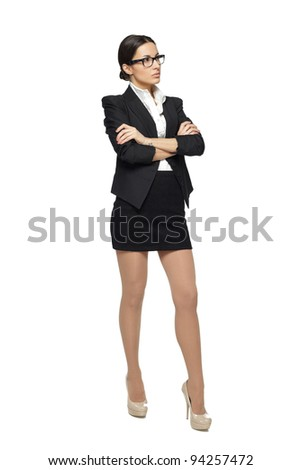 Business woman standing in full length with folded hands looking sideways, isolated on white background