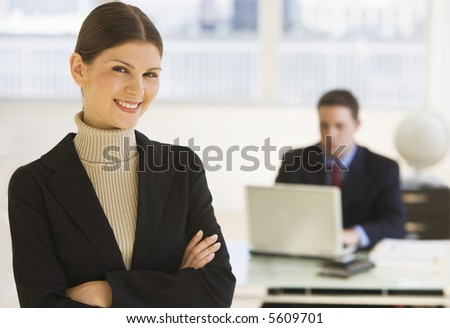 Business woman standing in the office - stock photo
