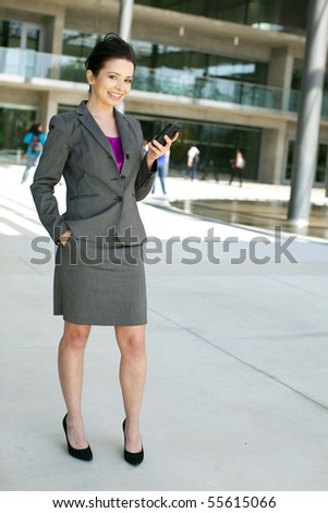 Business woman standing outside her office