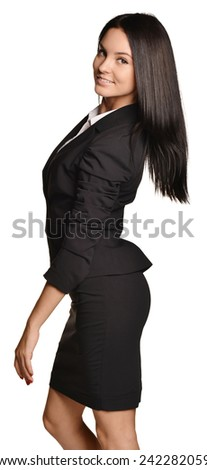 Business woman standing sideways leaning back slightly - stock photo