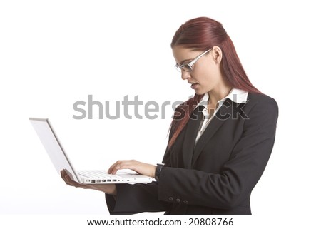 Business woman standing up working on a laptop computer