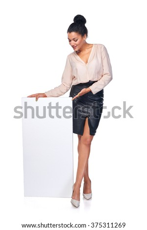 Business woman standing with blank white banner in full length presenting advertising your product, over white background - stock photo