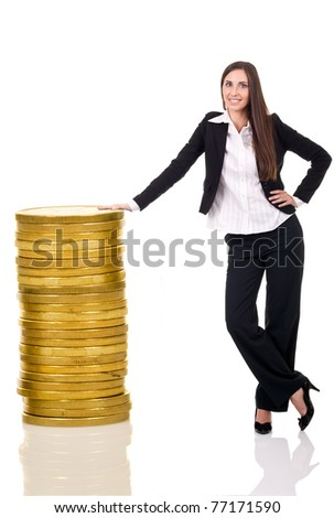 business woman standing with stack coins, isolated over a white background - stock photo