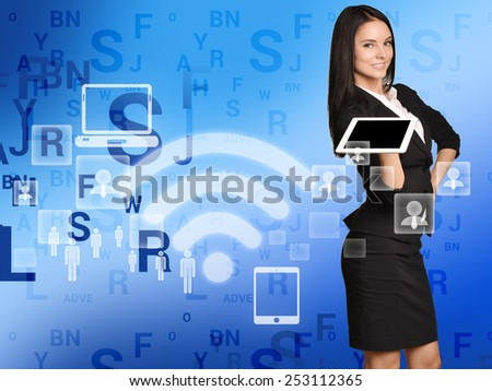 Business woman standing with tablet in his hands. modern applications.