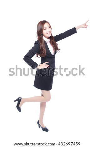 business woman stands in full length,pointing something,asia beauty - stock photo