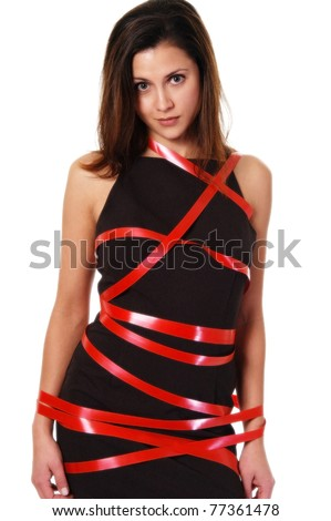 Business woman surrounded in red tape. - stock photo
