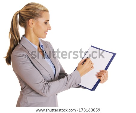 Business woman taking document, notebook for notes, and points at something with a pencil, isolated on white.