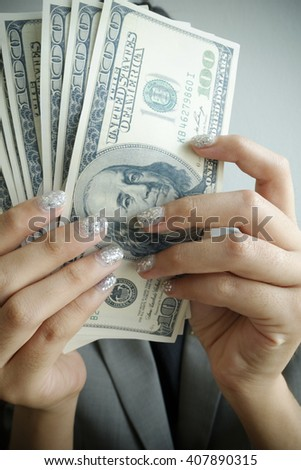 business woman  taking money  out of wallet  , financial concept