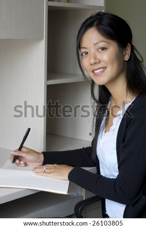Business woman taking notes in an office