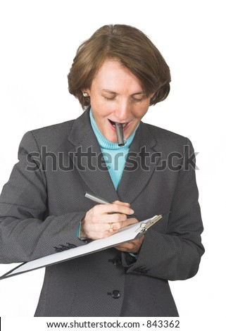 business woman taking notes on a folder with her pen top on her mouth - stock photo
