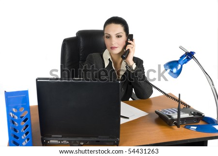 Business woman talking at phone and type on laptop - stock photo