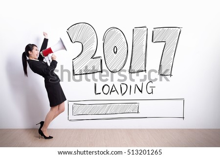 business woman talking in megaphone with 2017 new year on white wall background
