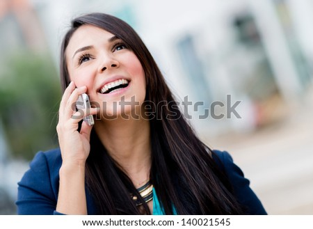 Business woman talking on her mobile phone - stock photo