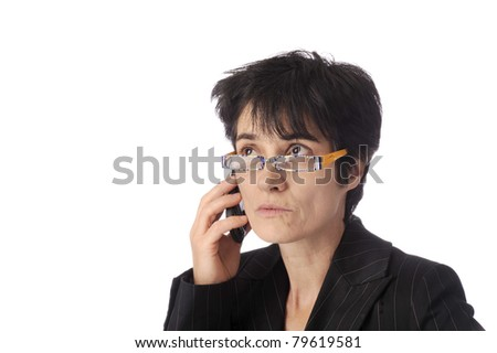 business woman talking on her mobile phone.Eyes up.  Isolated on white background - stock photo