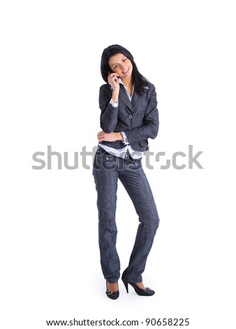 Business woman talking on her mobile phone isolated on white background - stock photo