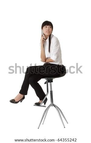 Business woman talking on phone and siting on chair, isolated on white. - stock photo